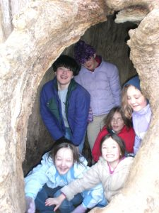 "Girl Scouts in the ""Pooh tree"" at Camp Potomac Woods after a Defend Yourself workshop."